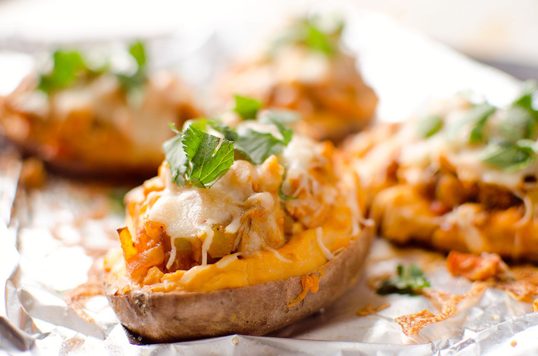 twice baked buffalo chicken sweet potatoes by the creative bite