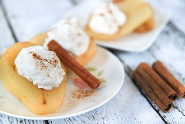 cider poached pears with cinnamon whipped cream greens and chocolate